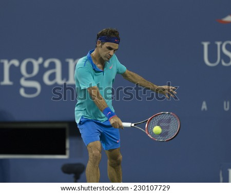 NEW YORK, NY - AUGUST 31, 2014: Roger Federer of Switzerland returns ball during 3rd round match against Marcel Granollers of Spain at US Open tennis tournament in Flushing Meadows USTA Tennis Center - stock photo