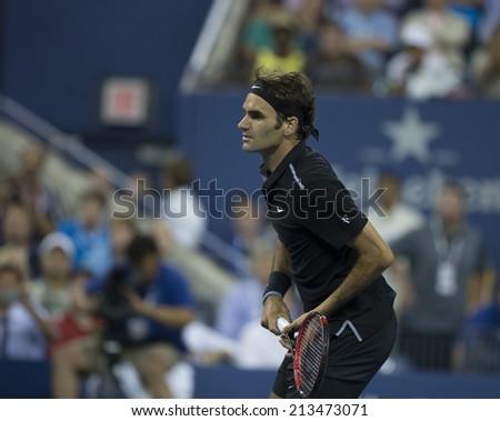 NEW YORK, NY - AUGUST 26: Roger Federer of Switzerland returns ball during 1st round match against Marinko Matosevic of Australia at US Open tennis tournament in Flushing Meadows USTA Tennis Center - stock photo