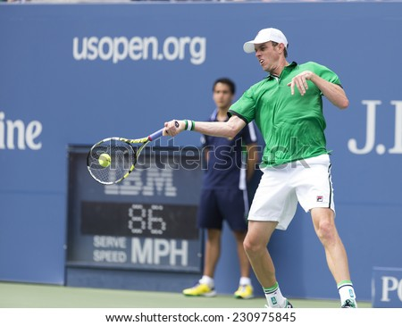 NEW YORK, NY - AUGUST 30, 2014: Sam Querrey of USA returns ball during 3rd round match against Novak Djokovic of Serbia at US Open tennis tournament in Flushing Meadows USTA Tennis Center - stock photo