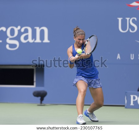 NEW YORK, NY - AUGUST 31, 2014: Sara Errani of Italy returns ball during 4th round match against Mirjana Lucic-Baroni of Croatia at US Open tennis tournament in Flushing Meadows USTA Tennis Center - stock photo