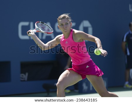 NEW YORK, NY - AUGUST 25: Simona Halep of Romania returns ball during 1st round match against Danielle Rose Collins of USA at US Open tennis tournament in Flushing Meadows USTA Tennis Center 2014 - stock photo