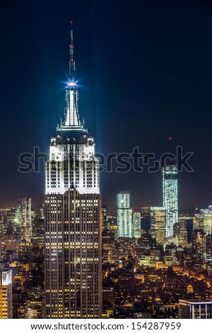NEW YORK, NY - AUGUST 2013: The top of the Empire State Building at night in New York, NY on August 24, 2103 in New York, NY - stock photo