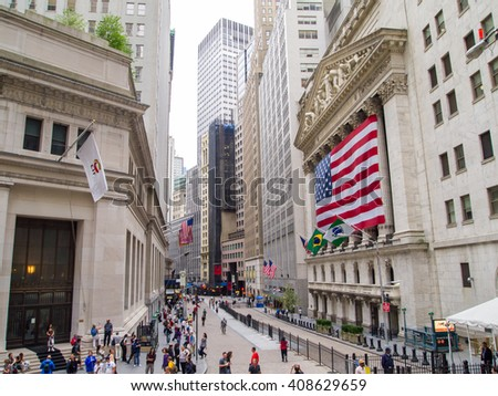 New York, NY: August 17, 2010: Tourists walking by an American-flag draped New York Stock Exchange.  In 2013, the average trading value on the New York Stock Exchange was $169 billion. - stock photo