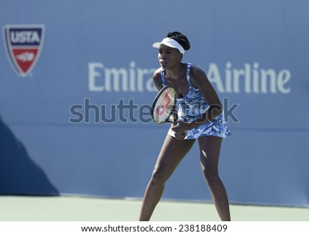 NEW YORK, NY - AUGUST 25: Venus Williams of USA returns ball during 1st round match against Kimiko Date-Krumm of Japan at US Open tennis tournament in Flushing Meadows USTA Tennis Center 2014 - stock photo