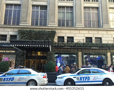 NEW YORK, NY - DEC 20: Holiday decor at Saks Fifth Avenue flagship store in New York, as seen on Dec 20, 2015. The store attracts passersby and tourists in the holiday season for its window displays. - stock photo