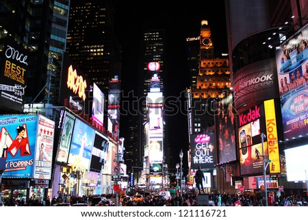 NEW YORK, NY - DECEMBER 6:Crowds gather in New York City's Times Square December 6, 2012. On New Year's Eve, close to a million people will congregate to celebrate the 'Dropping of the Ball'. - stock photo