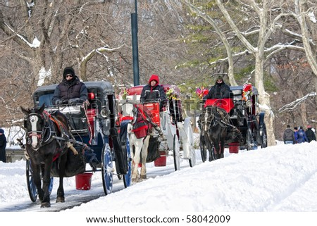 NEW YORK, NY - DECEMBER 20: Horse carriages in line at the Central park in Manhattan on December 20, 2009 in New York, New York. - stock photo