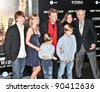 NEW YORK, NY - DECEMBER 07: Jon Bon Jovi with family and producer Garry Marshall  poses for a photo during the 'New Year's Eve' premiere at Ziegfeld Theatre on December 7, 2011 in New York City. - stock photo