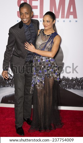 NEW YORK, NY - DECEMBER 14, 2014: Musician-actor Keith Stanfield (L) and actress Tessa Thompson attend the 'Selma' New York Premiere at the Ziegfeld Theater - stock photo