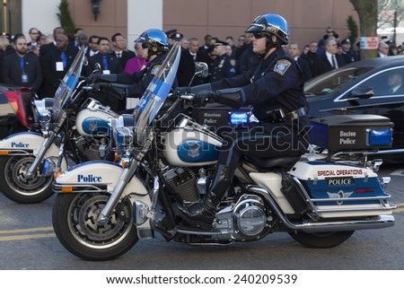 NEW YORK, NY - DECEMBER 27, 2014: Police officer on Motorcycle from Boston attends Christ Tabernacle Church for the funeral of slain New York City Police Officer Rafael Ramos - stock photo