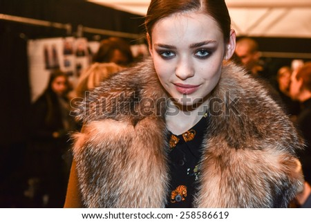 NEW YORK, NY - FEBRUARY 13: A model getting ready backstage at the Nicole Miller fashion show during MBFW Fall 2015 at Lincoln Center on February 13, 2015 in NYC. - stock photo