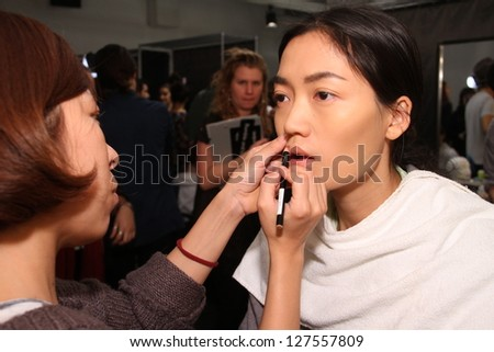 NEW YORK, NY - FEBRUARY 06: A model is prepared backstage at the Rachel Comey fall 2013 fashion show during Mercedes-Benz Fashion Week at Pier 59 on February 6, 2013 in New York City.