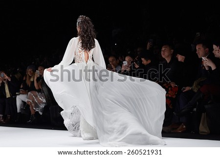 NEW YORK, NY - FEBRUARY 19: A model walks runway at the New York Life fashion show during MBFW Fall 2015 at Lincoln Center on February 19, 2015 in NYC. - stock photo