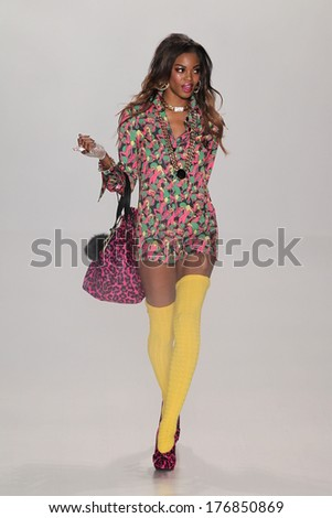 NEW YORK, NY - FEBRUARY 12: A model walks the runway at Betsey Johnson during Mercedes-Benz Fashion Week Fall 2014 at Lincoln Center on February 12, 2014 in New York City. - stock photo