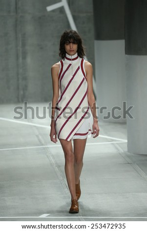 NEW YORK, NY - FEBRUARY 14: A model walks the runway at Lacoste fashion show during Mercedes-Benz Fashion Week Fall 2015 at Lincoln Center on February 14, 2015 in New York City - stock photo