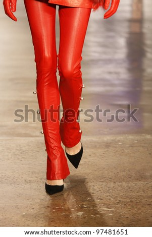 NEW YORK, NY - FEBRUARY 12: A model walks the runway at the Kevork Kiledjian Fall 2012 fashion show during Mercedes-Benz Fashion Week at Lincoln Center on February 12, 2012 in New York City.