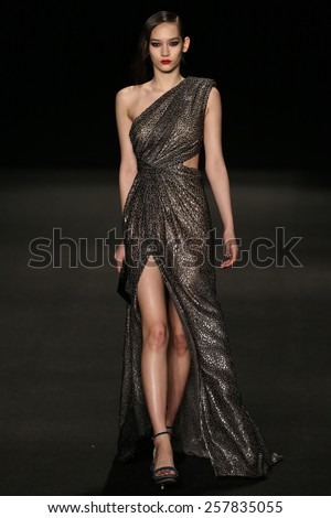 NEW YORK, NY - FEBRUARY 13: A model walks the runway at the Monique Lhuillier fashion show during MBFW Fall 2015 at Lincoln Center on February 13, 2015 in NYC - stock photo