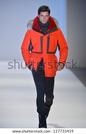 NEW YORK, NY - FEBRUARY 08: A model walks the runway at the Nautica Fall Winter 2013 fashion show during Mercedes-Benz Fashion Week on February 8, 2013, NYC. - stock photo