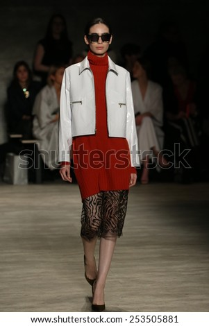 NEW YORK, NY - FEBRUARY 12: A model walks the runway at the Tome fashion show during Mercedes-Benz Fashion Week Fall 2015 at Lincoln Center on February 12, 2015 in New York City. - stock photo