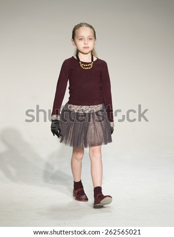 New York, NY - February 28, 2015: A model walks the runway for IMOGA collection by HJ Chung during petitePARADE / Kids Fashion Week at Bathhouse Studios - stock photo