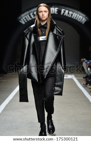 NEW YORK, NY - FEBRUARY 05: A model walks the runway for the designs of Melitta Baumeister for VFiles Made Fashion 2 show during Mercedes Benz Fashion Week on February 5, 2014 in New York City. - stock photo