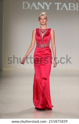 NEW YORK, NY - FEBRUARY 19: A model walks the runway in a design by Dany Tabet at the New York Life fashion show during MBFW Fall 2015 at Lincoln Center on February 19, 2015 in NYC.  - stock photo