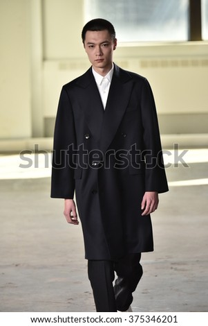 NEW YORK, NY - FEBRUARY 02: A model walks the runway wearing Duckie Brown during New York Fashion Week Men's Fall/Winter 2016 on February 2, 2016 in NYC.