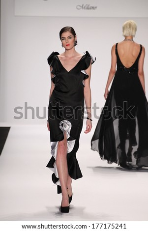 NEW YORK, NY - FEBRUARY 13: A model walks the runway wearing Gianni Tolentino at the FLT Moda + Art Hearts Fashion show during Mercedes-Benz Fashion Week Fall 2014 on February 13, 2014 in NYC. - stock photo