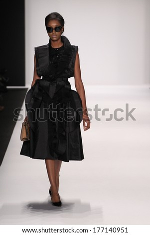 NEW YORK, NY - FEBRUARY 13: A model walks the runway wearing Nino Lettieri designer dress at the FLT Moda + Art Hearts show during Mercedes-Benz Fashion Week Fall 2014 on February 13, 2014 in NYC.