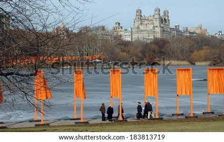 New York, NY - February 15, 2005:  Artist Christo's art installation The Gates in line the frozen boating lake in Central Park with the San Remo Apartments in the distance - stock photo