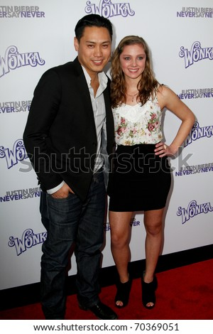 "NEW YORK, NY - FEBRUARY 02: Director Jon Shu and Lynsey Mickolas attend ""Justin Bieber: Never Say Never"" New York movie premiere at the Regal E-Walk 13 Theater on February 2, 2011 in New York City. - stock photo"
