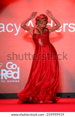 NEW YORK, NY - FEBRUARY 12: Fifth Harmony performs on the runway at the Go Red For Women Red Dress Collection 2015 fashion show during MBFW Fall 2015 at Lincoln Center on February 12, 2015 in NYC - stock photo