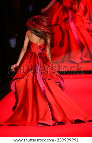 NEW YORK, NY - FEBRUARY 12: Fifth Harmony performs on the runway at the Go Red For Women Red Dress Collection 2015 fashion show during MBFW Fall 2015 at Lincoln Center on February 12, 2015 in NYC