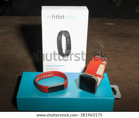 NEW YORK, NY - FEBRUARY 11, 2016: Fitbit fitness wrist band and watch on dispaly backstage for the Heart Truth Red Dress Collection 2016 fashion show at Moynihan Station - stock photo