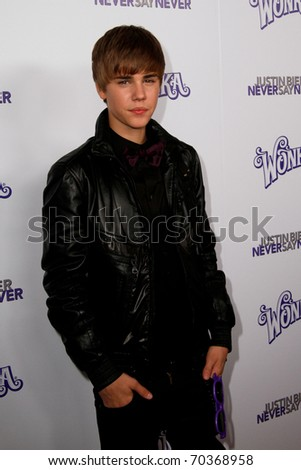 "NEW YORK, NY - FEBRUARY 02: Justin Bieber attends the ""Justin Bieber: Never Say Never"" New York movie premiere at the Regal E-Walk 13 Theater on February 2, 2011 in New York City. - stock photo"