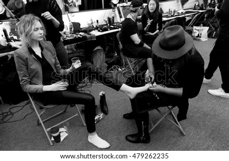 New York, NY - February 11, 2016: Maja Brodin prepares backstage for the BCBGMAXAZRIA Fall 2016 fashion show during New York Fashion Week