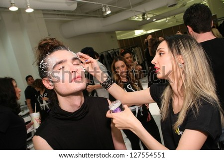 NEW YORK, NY- FEBRUARY 07: Makeup artist applying make-up to model backstage at the Elliott Evan Collection for F/W 2013 during Mercedes-Benz Fashion Week on February 07, 2013 in NYC.
