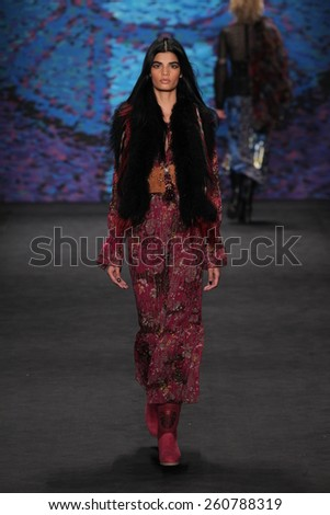 NEW YORK, NY - FEBRUARY 18: Model Bhumika Arora walks the runway at the Anna Sui fashion show during MBFW Fall 2015 at Lincoln Center on February 18, 2015 in NYC - stock photo