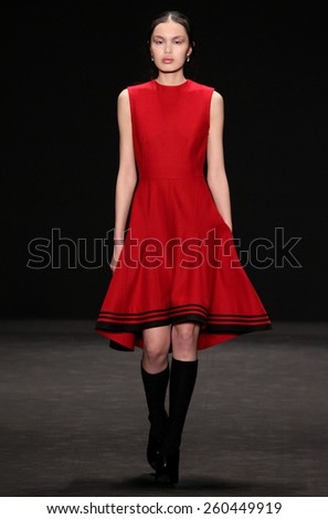 NEW YORK, NY - FEBRUARY 16: Model walks the runway at the Vivienne Tam fashion show during Mercedes-Benz Fashion Week Fall 2015 on February 16, 2015 in NYC. - stock photo