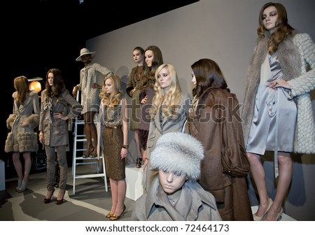 NEW YORK, NY - FEBRUARY 11: Models pose at the Norman Ambrose Fall 2011 presentation during Mercedes-Benz Fashion Week at The Box at Lincoln Center on February 11, 2011 in New York City.