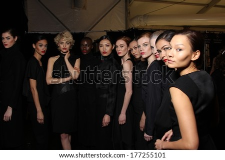 NEW YORK, NY - FEBRUARY 13: Models pose backstage wearing designer dress at the FLT Moda + Art Hearts Fashion show during Mercedes-Benz Fashion Week Fall 2014 on February 13, 2014 in New York City. - stock photo