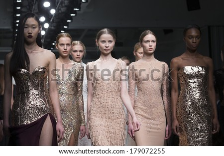 NEW YORK, NY - FEBRUARY 11, 2014: Models walk runway for Australian Fashion Palette show by Steven Khalil during New York Fall/Winter 2014 Fashion Week at Pier 59 - stock photo