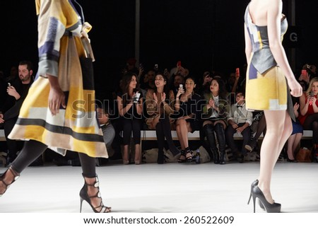 NEW YORK, NY - FEBRUARY 19: Models walk the runway at the New York Life fashion show during MBFW Fall 2015 at Lincoln Center on February 19, 2015 in NYC. - stock photo