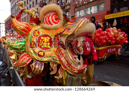 NEW YORK, NY - FEBRUARY 17 : Parade on streets in Chinatown during the Annual Lunar New year on February 17, 2013 in New York City. This year celebrates the Year of the Snake. - stock photo