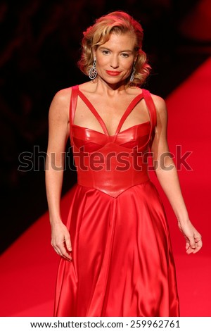 NEW YORK, NY - FEBRUARY 12: Tracy Anderson walks the runway at the Go Red For Women Red Dress Collection 2015  fashion show during MBFW Fall 2015 at Lincoln Center on February 12, 2015 in NYC
