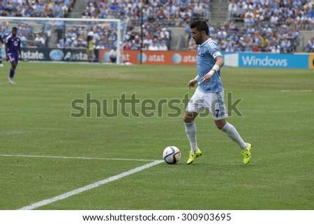 New York, NY - July 26, 2015: David Villa (7) controls ball during game between New York City Football Club and Orlando City SC at Yankee Stadium - stock photo