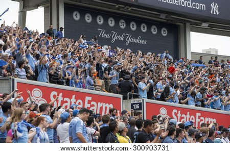 New York, NY - July 26, 2015: Fans of NYCFC celebrate goal during game between New York City Football Club and Orlando City SC at Yankee Stadium