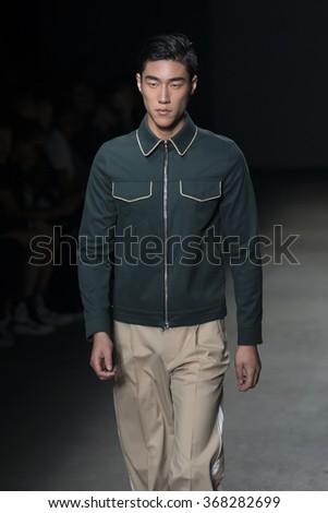 NEW YORK, NY - JULY 14, 2015: Shi Qifan walks the runway during the Concept Korea show at New York Fashion Week Men's S/S 2016 at Skylight Clarkson Sq - stock photo