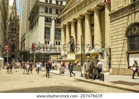 NEW YORK, NY - JUNE 23, 2014: New York lunchtime locals and tourists in front of the New York Stock Exchange building in lower Manhattan, a National Historic Landmark since 1978. - stock photo