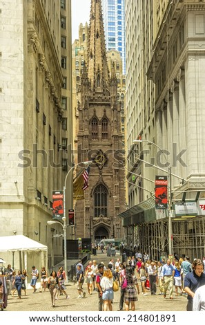 NEW YORK, NY - JUNE 23, 2014: Trinity Church, built in 1846, and located at Broadway and Wall streets, is a historic and functioning parish church in the Episcopal Diocese of New York. - stock photo